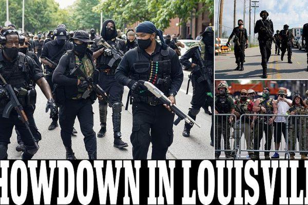 استعراض الميليشيات السود الاميركيه المسلحة حتى اسنانها يطالبون بتوجيه اتهامات ضد رجال الشرطة